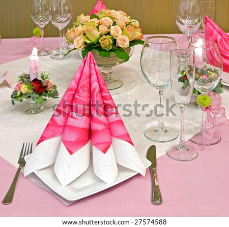 Wedding table decorated with bouquet and candles