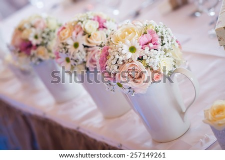 Wedding table decoration, flowers in vase. above. Shallow depth of field.