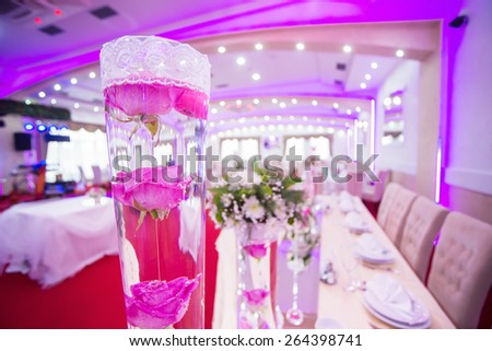 Wedding table decoration, flowers in vase full of water. Shallow depth of field.