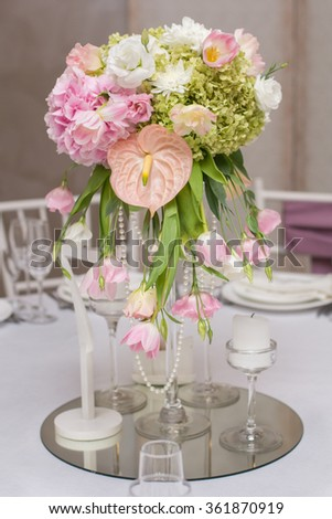 Wedding Table Decoration. Table set for a wedding dinner. Beautiful flowers on table in wedding day.