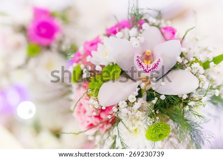 Wedding table decoration, wedding setting, wedding flowers on table, shallow depth of field. - stock photo
