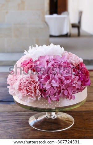 Wedding table decoration with pink peonies and carnations - stock photo
