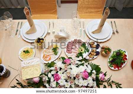Wedding table for the bride and groom in restaurant - stock photo