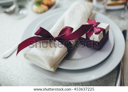 Wedding table. Gift set for guests, spoon, fork, knife, plate.