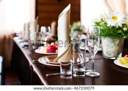 Wedding table in restaurant decorated with  flower composition