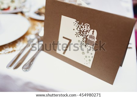 Wedding table number seven in the restaurant - stock photo