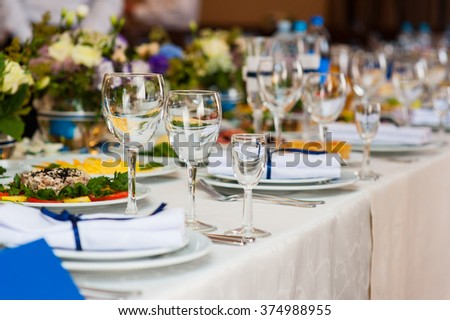 Wedding table served and decorated in a restaurant. - stock photo