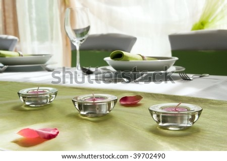 wedding table set with composition of lamps and rose - stock photo