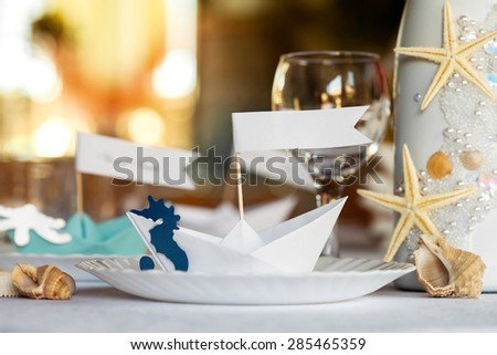 Wedding table setting in nautical style. - stock photo