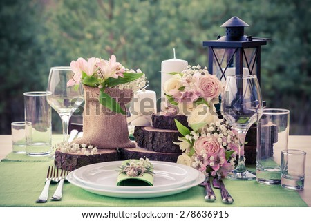 Wedding table setting in rustic style. - stock photo