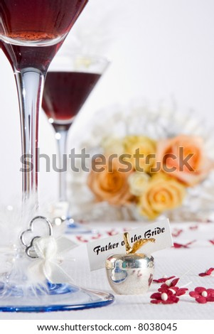 Wedding table with blurred bouquet and decorations
