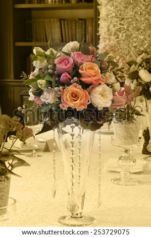 Wedding table with bouquets of roses and buttercups in vintage style - stock photo