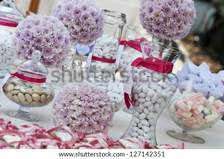 wedding table with confetti and candies - stock photo