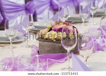 wedding table with flower and glasses
