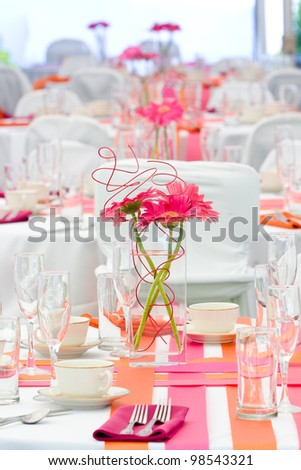 Wedding tables set for fun dining during a banquet or wedding event - stock photo