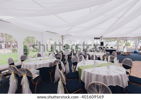 Wedding tables under a tent decorated ,wedding reception. - stock photo