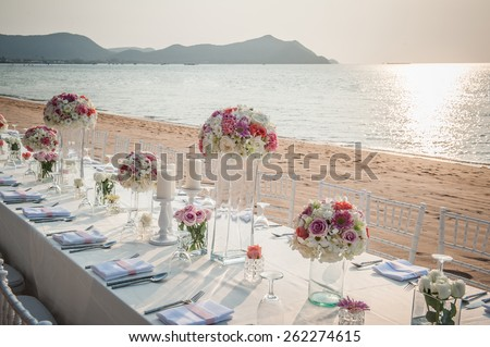 wedding The elegant dinner table on the beach - stock photo
