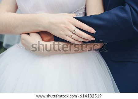 Wedding theme, holding hands newlyweds