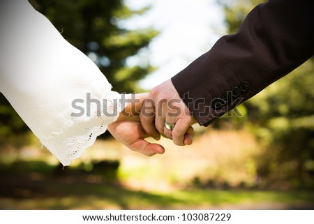 wedding theme, holding hands newlyweds, wedding - stock photo