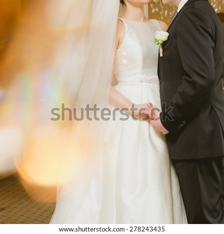 wedding theme. The bride and groom holding hands - stock photo