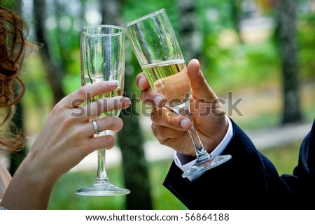 wedding theme, the hand with a glass of champagne - stock photo