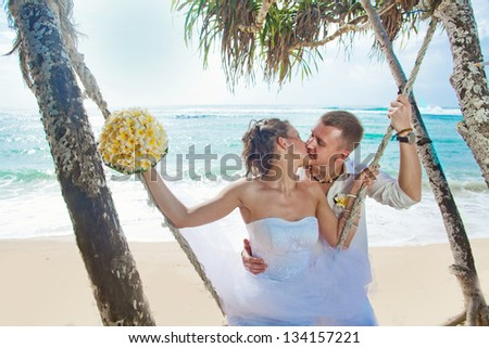 wedding under palm tree - stock photo