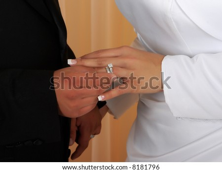 Wedding vows sealed with a ring ( a diamond is forever) - stock photo