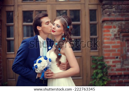 Wedding walk. The groom and the bride in an ancient castle - stock photo