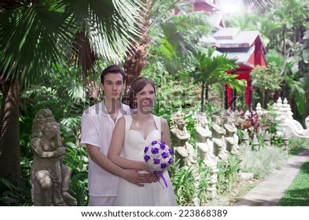 Wedding walk. The groom and the bride in Thailand, the island Samui - stock photo