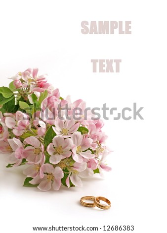 Wedding. Wedding card. Wedding  flowers. Wedding rings and spring flowers. Wedding Rings and Wedding Rings on white. Wedding still life. Wedding card with wedding rings. Wedding rings and blossoms. - stock photo