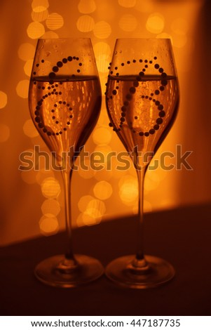 Wedding wineglasses with candles and cake - stock photo