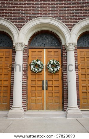 Wedding Wreaths on Arched Doors - stock photo