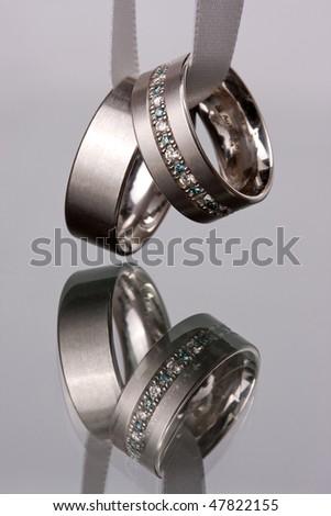 Weddingring in a ribbon - stock photo