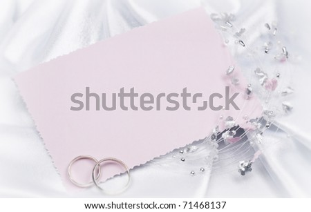 Weddings accessorie a buttonhole  on a card for invitation or congratulation - stock photo