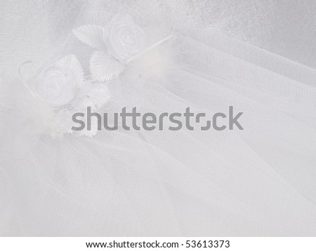 Weddings accessorie a buttonhole  on a lace background - stock photo