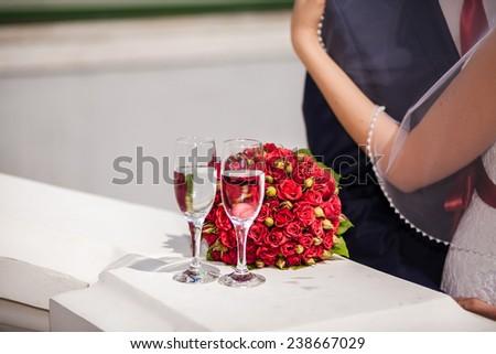 weddings bouquet and bride groom hands - stock photo