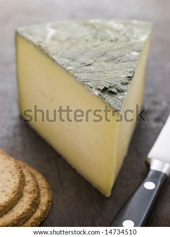 Wedge of Cornish Yarg Cheese with Oatmeal Biscuits - stock photo