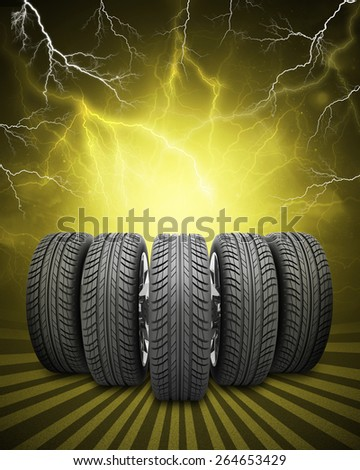 Wedge of new car wheels. Abstract yellow background with lightning and stripes at bottom - stock photo