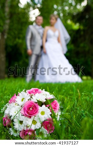weding bouquet on a grass - stock photo