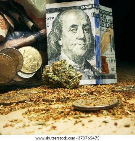 weed and hundred dollar bill, marijuana business money - stock photo