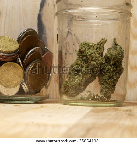 Weed and Money, Marijuana Bud & American and Foreign Dollar Bills