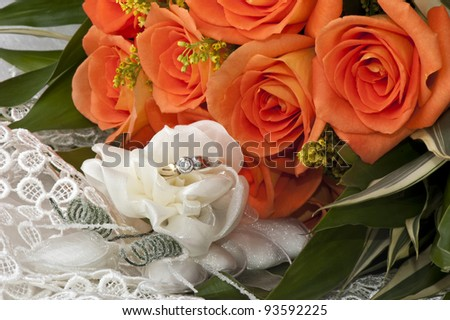 weeding Favors, wedding rings and orange roses - stock photo