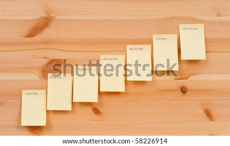Week Day Note Pads on wood - stock photo
