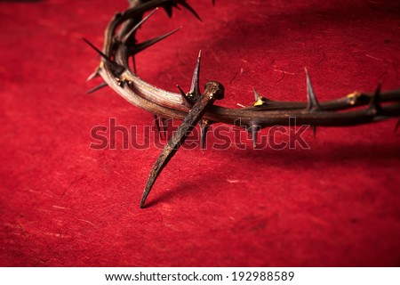 week of passion. Jesus Christ crown of thorns and a nail on red background - stock photo