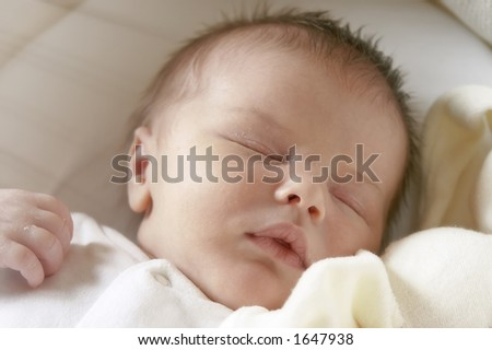 Week old beautiful baby boy asleep, soft dreamy focus