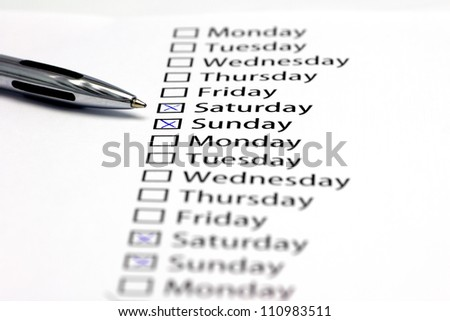 weekend crossed in check box in a row of days of the week. No working today - stock photo