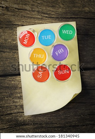 Weekly Pin with Sticky Note - stock photo