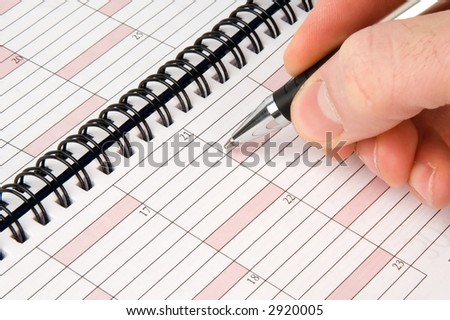 Weekly planner with pen on the top - stock photo