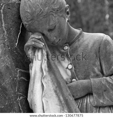 weeping girl- cemetery statue, Italy - stock photo