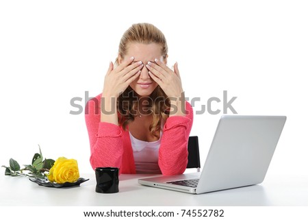 Weeping woman at a computer. Isolated on white background - stock photo